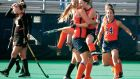 Emma Russell celebrates with her Syracuse University teammates.