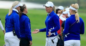 Suzann Pettersen of the European team trying to explain to her captain Carin Koch the length of putt that she did not concede to Alison Lee on the 17th green. Photograph: David Cannon/Getty Images