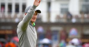 Amateur Paul Dunne of Ireland waves to the crowd as he walks off the 1st tee during the final round of the 144th Open Championship. Photograph: Matthew Lewis/Getty Images