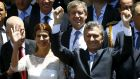 Argentina's president Mauricio Macri and his wife Juliana Awada wave at the crowd after being sworn-in as president in Buenos Aires, Argentina. Photograph: Enrique Marcarian/Reuters