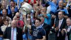 Leinster  chairman John Horan with Dublin  captain Stephen Cluxton as he lifted the Delaney Cup last July. Photograph: Donall Farmer/Inpho