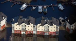 Marooned: buildings surrounded by flood waters in Carrick-on-Shannon. Photograph: Brenda Fitzsimons