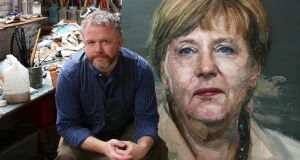 Irish artist Colin Davidson  with his painting of Angela Merkel which made the front cover of Time magazine. The Belfast artist was commissioned by Time which has made the German chancellor its person of the year.