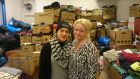 Anna Idell (right) of the Centre for All drop-in/resource centre and Afraa from Aleppo in Syria, a volunteer in the clothes bank. Photograph: Derek Scally