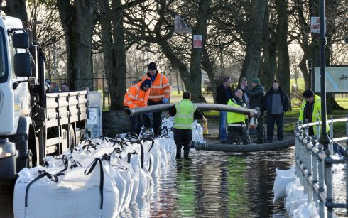 Residents shore up  flood defences on the eastern side of the river Shannon in Athlone. Photograph: Alan Betson/The Irish Times