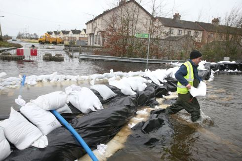 Local Councillor Kevin Moran helps with flood defences in Athlone. Photograph: Brian Lawless/PA Wire