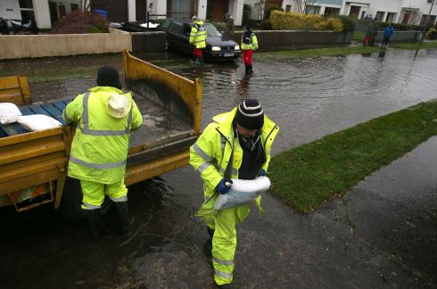 People working on flood defences in Athlone. Photograph: Brian Lawless/PA Wire