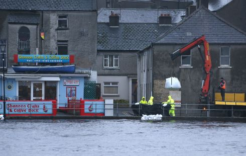 Sandbags are placed along the quayside in Athlone, by the river Shannon. Photograph: Brian Lawless/PA Wire