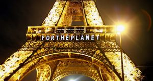 The slogan 'For the Planet'  is projected on the Eiffel Tower as part of the COP21, United Nations Climate Change Conference in Paris, France, on Friday night. Photograph: AP