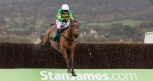More Of That ridden by Barry Geraghty clears the last fence before going on to win  at Cheltenham. Photograph: PA