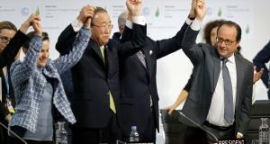 From left are Christiana Figueres, executive secretary of the UN Framework Convention on Climate Change; United Nations Secretary-General Ban Ki-moon, French Foreign Affairs Minister Laurent Fabius, and president-designate of COP21 and French President Francois Hollande celebrating  final agreement  at the World Climate Change Conference 2015 (COP21) at Le Bourget, near Paris, France, December 12th, 2015. Photograph: Stephane Mahe/Reuters
