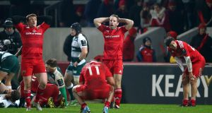 A dejected Tomas O'Leary after the final whistle as Munster suffer a frustrating defeat at the hands of Leicester Tigers Photograph: Cathal Noonan/Inpho