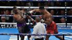 Anthony Joshua knocked out Dillain Whyte in the seventh round to win the British heavyweight title. Photograph: Getty