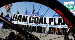 Environmentalists urging a ban on coal-burning plants take part in a bicycle ride to show solidarity for the global movement for climate justice in Manila, the Philippines on Sunday, December 13th, 2015. Photograph: Jay Directo/AFP/Getty Images