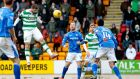 Nadir Ciftci heads home Celtic's third goal in their Scottish Premiership clash with St Johnstone at  McDiarmid Park. Photograph:  Graham Stuart/Action Images via Reuters/Livepic