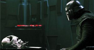 Dark ambition: Kylo Ren (Adam Driver) contemplates the late Darth Vader in Star Wars: The Force Awakens