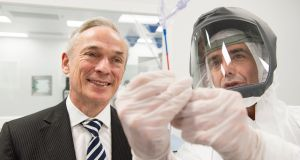 Minister for Enterprise Richard Bruton with Gary Corbett of Medtronic: The medical device giant manufactures drug-coated balloons for   artery disease. Photograph: Andrew Downes
