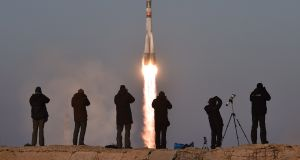 Photographers take pictures as Russia's Soyuz TMA-19M spacecraft carrying the International Space Station (ISS) Expedition 46/47 crew of Britain's astronaut Tim Peake, Russian cosmonaut Yuri Malenchenko and US astronaut Tim Kopra blasts off from the launch pad in Kazakhstan. Photograph: Kirill Kudryavtsev/AFP/Getty Images