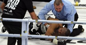 Roy Jones Jr lies on the canvas  after being knocked out by  Enzo Maccarinelli in Moscow. Photograph: Vasily Maximov/AFP/Getty Images
