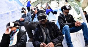 Testing virtual reality headsets. Photograph: Loic Venance/AFP/Getty Images