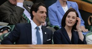 Michelle Dockery and John Dineen pictured in the Royal Box on Centre Court at the All England Lawn Tennis and Croquet Club, Wimbledon in 2014.  Photograph: Anthony Devlin/PA Wire