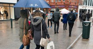 Shoppers on Grafton Street, Dublin, during a warm and wet December. photograph: Dave Meehan