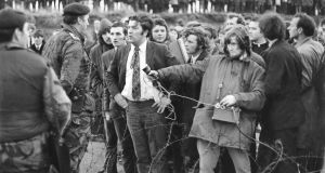 John Hume speaks to a British  soldier at a Magiligan Anti-Internment Rally in Derry in 1972. Photograph: Jimmy McCormack