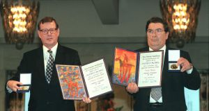 Nobel Peace Prize winners David Trimble and John Hume MEP display the Alfred Nobel medals and diplomas at the presentation ceremony in Oslo City Hall in 1998. Photograph: Matt Kavanagh