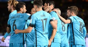 Barcelona celebrate Luis Suarez's opener in their 3-0 Club World Cup semi-final win over Guangzhou Evergrande. Photograph: Getty