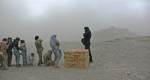 Brick Sellers of Kabul (2006) by Lida Abdul. Courtesy of the artist and Giorgio Persano Gallery