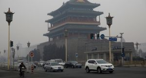 A file picture dated shows vehicles in front of the Qianmen Gate Tower during hazy day in Beijing, China. Photograph: EPA