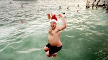 Alan Heffernan from Shankill joins swimmers on a cold and windy Christmas day swim at Dublins Forty Foot. Photograph: Alan Betson