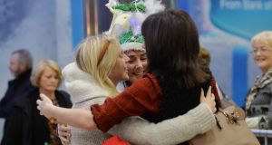 Danielle O'Halloran embraces friends Joanne Quinn and Therese Lyons from Thurles on her return from Australia after three and a half years abroad, at the Arrivals area in Dublin Airport. Photograph: Alan Betson / The Irish Times