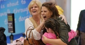 Sarah Tighe embraces her mother Linda Tighe and cousin Anna from Terenure on her return from Australia after 10 months abroad, at the arrivals area in Dublin Airport. Photograph: Alan Betson / The Irish Times