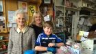 Bridie Mooney (86) in her Greystones shop with her grandson Tadhg (11) and daughter Aine. Photograph: Peter Murtagh