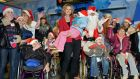 Adi Roche with a group of 31 special needs children – many of whom have come from disturbed and violent backgrounds – arriving at Dublin Airport, from the Chernobyl region of Belarus to spend Christmas with host families in Ireland. Photograph: Eric Luke/The Irish Times