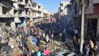 Syrians gather at the scene of a car bomb attack in Homs. Photograph: EPA/STR