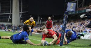 Toulon's Drew Mitchell is denied a try by Leinster's Seán Cronin and Isa Nacewa. Photograph: Brian Lawless/PA Wire