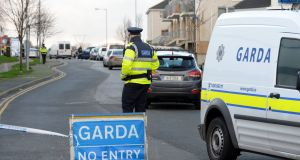 Gardaí at the scene of the siege in the Deerpark housing estate in Tallaght, Dublin. Photograph: Eric Luke