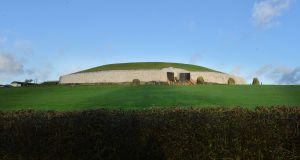 Newgrange on December 21st, 2015, after the weather had cleared. Rain and cloud on the horizon at sunrise blocked sunlight from entering the monument's chamber.  Photograph: Alan Betson/The Irish Times