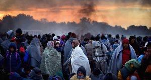 Migrants are held back in Slovenia in October. Photograph: Jeff J Mitchell/Getty