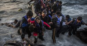 Dangerous journey: refugees arrive on the Greek island of Lesbos in October. Potograph: Matej Divizna/Getty