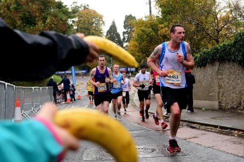 Bystanders offer sustenance as runners press on through the 22-mile mark on Heartbreak Hill, Roebuck during the Dublin City Marathon in October. Photograph: Cyril Byrne
