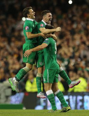 Wes Hoolahan, Robbie Brady and  Shane Long of Republic of Ireland celebrate a famous victory against Germany after the Uefa Euro 2016 qualifying match at the Aviva Stadium in October. Photograph: Lorraine O'Sullivan