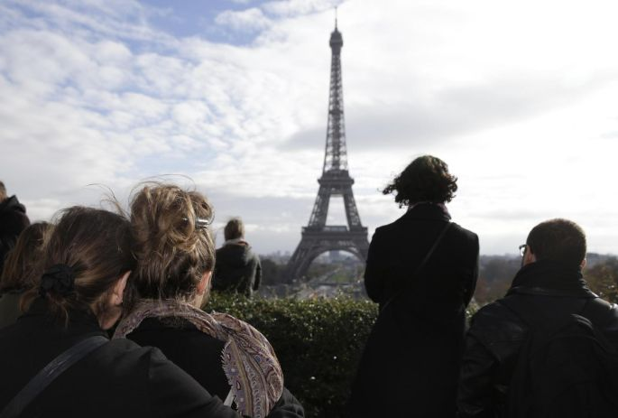 Observing a minute's silence at the Place de Trocadero in Paris on November 16th, following the terrorist attacks on the 13th. At least 129 were killed and more than 350 were injured in attacks for which Islamic State claimed responsibility. Photograph: Kenzo Tribouillard/AFP/Getty Images