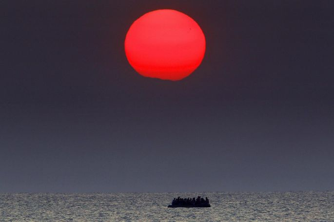 A dinghy overcrowded with Syrian refugees drifts in the Aegean sea between Turkey and Greece in August. Photograph: Yannis Behrakis/Reuters