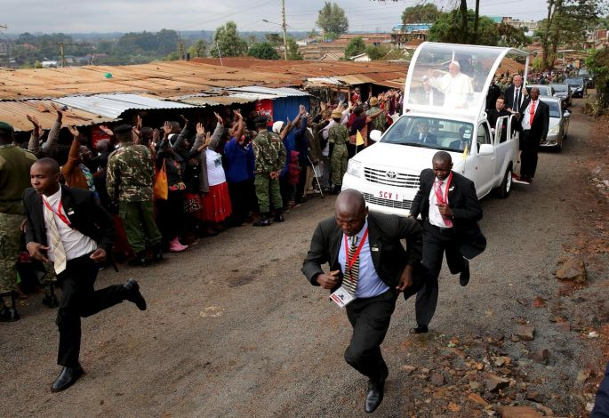 Securing the welcome – Pope Francis waves as he arrives at the Kangemi slums on the outskirts of Kenya's capital Nairobi in November. Photograph: Goran Tomasevic/Reuters