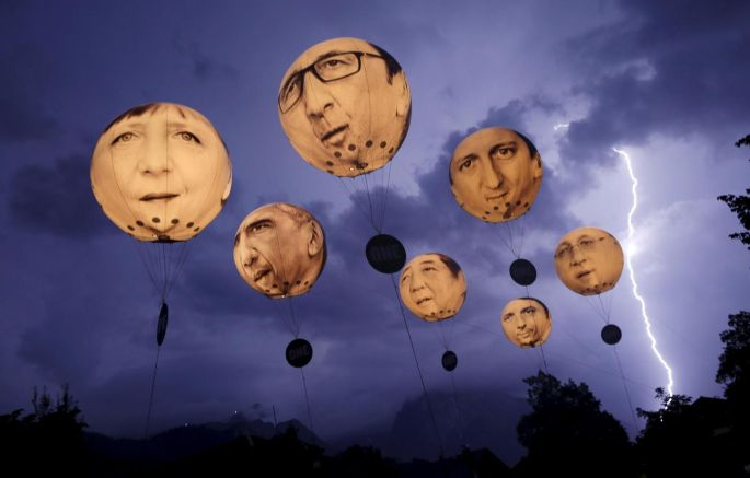 Hot air – lightning strikes the Alps over Garmisch-Partenkirchen in June as balloons made by the 'ONE' campaign against poverty depicting leaders of the G7 float by. Photograph: Wolfgang Rattay/Reuters
