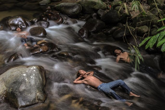 Malaysian youths cool off in a river in October, as schools in Hulu Langat remained closed due to hazy conditions. Malaysia, Singapore and expanses of Indonesia suffered for weeks with acrid smoke from fires on Indonesian plantations and peatlands being illegally cleared. Photograph: Mohd Rasfan/AFP/Getty Images