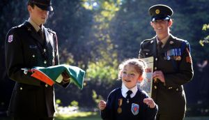 Mary Hannon (10) wears her great-grandfather's Old IRA service medal, with Lieut Stephen Cunningham and Sgt Amy Hopkins. Photograph: Eric Luke/The Irish Times